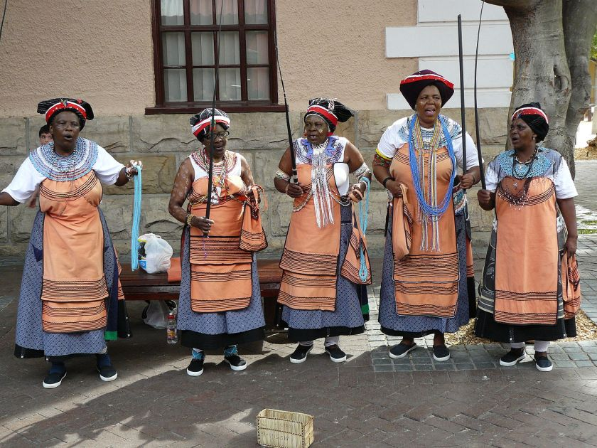 Five Xhosa women performing in traditional Xhosa costumes and facepaintings. Picture from the Waterfront in Cape Town. Source: Chell Hill