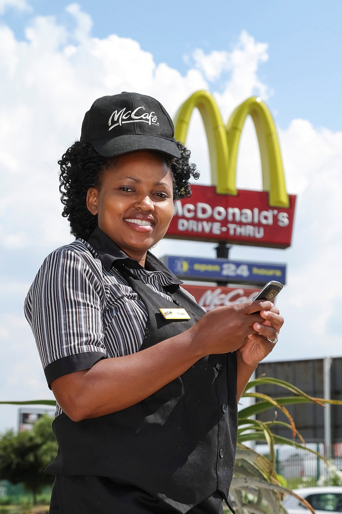 McDonald's staff member in Johannesburg, South Africa, signing up to social networking to communicate faster. Source: IBM